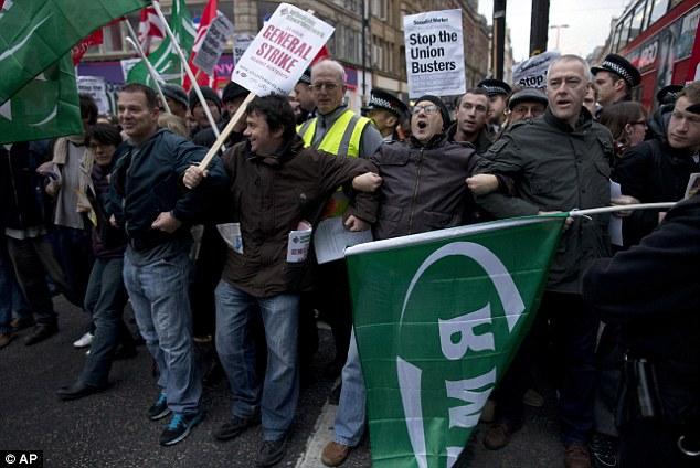 Road block: Protesters form a human chain to block traffic on one side of Oxford Street in a demonstration against austerity measures and the dismissal of Crossrail workers