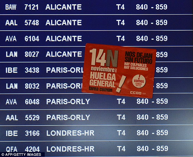 Delay: A sticker reading 'General strike' is stuck on a flight information board at Madrid Barajas airport