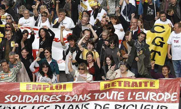 France: Workers shout slogans and hold a banner during a demonstration against austerity in Marseille