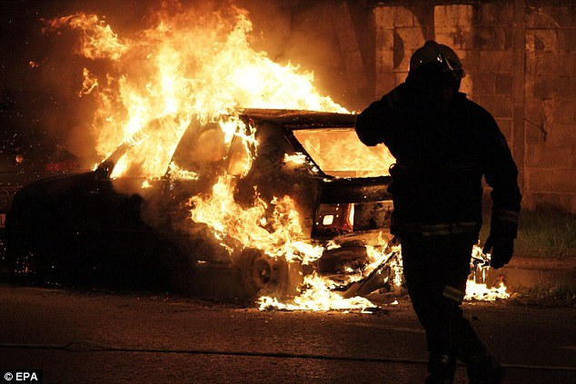 Blaze: A car set on fire by protesters on an industrial estate to cut off access to the city Lugo in northwestern Spain