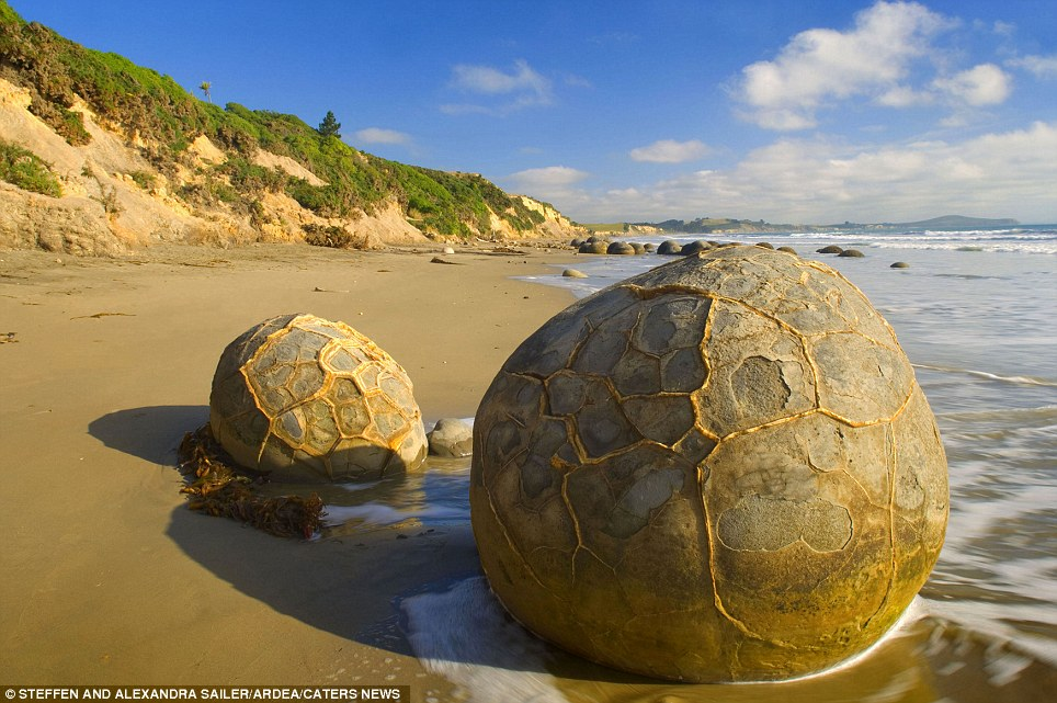 The Moeraki Boulders: (New Zealand) The gigantic boulders started forming on the ocean floor and can now been seen sitting mysteriously on the coastline thanks to centuries of erosion