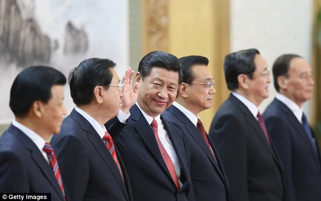The new team: He and the six other men who will form China's new collective leadership, all dressed in dark suits, walked in line onto the red-carpeted stage