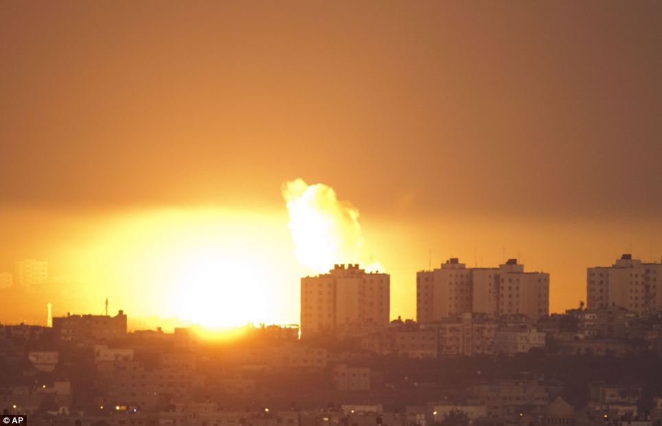 Dawn strike: Explosion and smoke rise following an Israeli air strike in the northern Gaza Strip. The attack resulted in the death of eleven Palestinians including children