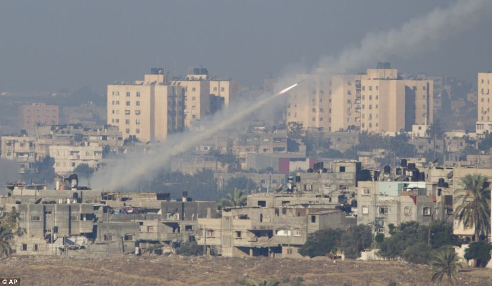 Retaliation: A rocket launched by Palestinians militants towards Israel makes its way from the northern Gaza Strip