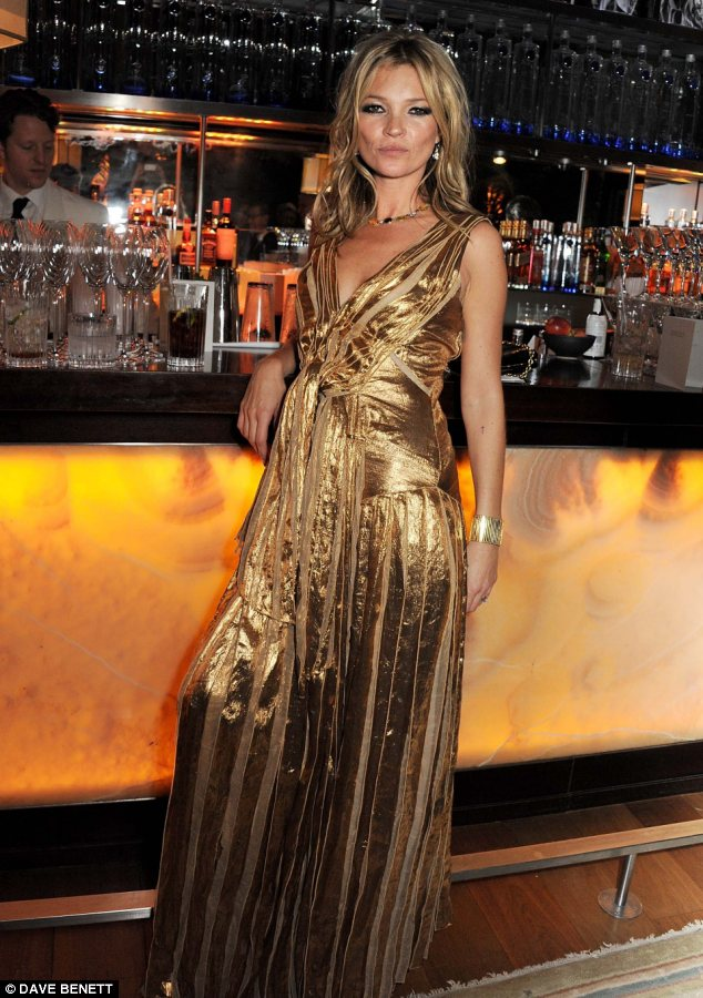 Propping up the bar: Kate posed for a series of snaps at the event where guests were treated to Ciroc vodka drinks
