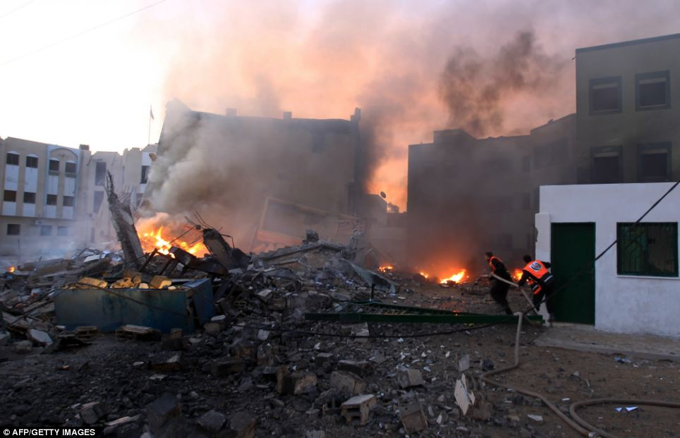 Destruction: Palestinians extinguish a fire, three days of fierce fighting between Israel and Gaza militants has widened the instability gripping the region, straining already frayed Israel-Egypt relations