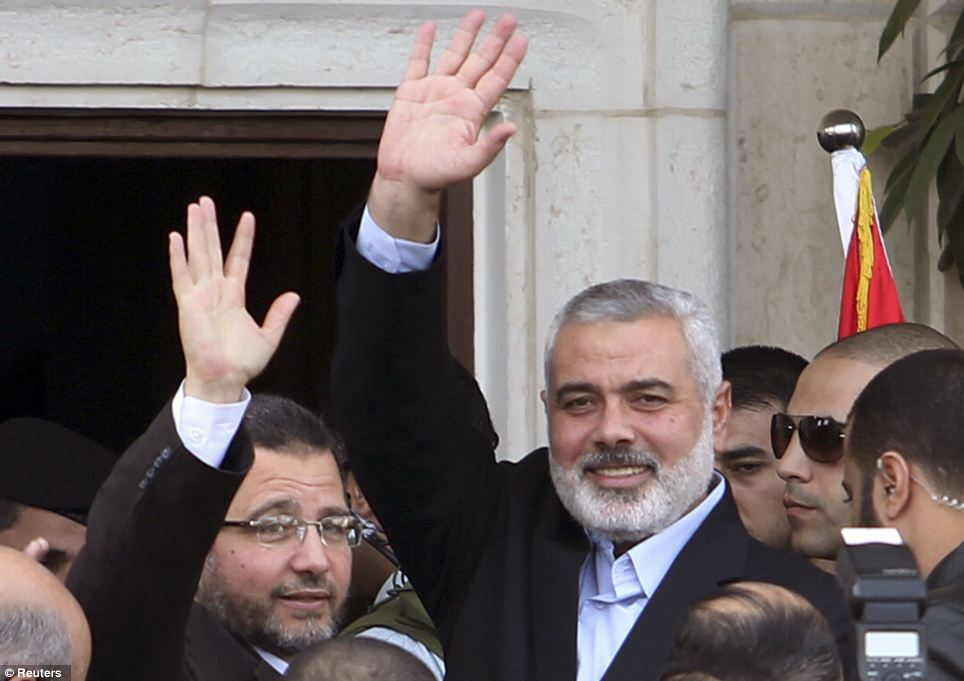 Tour: Egyptian Prime Minister Hisham Kandil (left) and senior Hamas leader Ismail Haniyeh. The PM visited a hospital and talked to Palestinian politicians saying said Israeli 'aggression' must stop