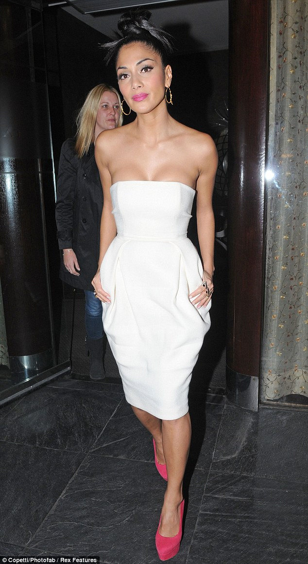 All white: Nicole Scherzinger exudes sultry elegance in a simple white dress as she head out for dinner in London on Thursday