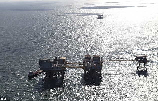 Out at sea: This aerial photograph shows the Black Elk oil rig damaged from an explosion and fire