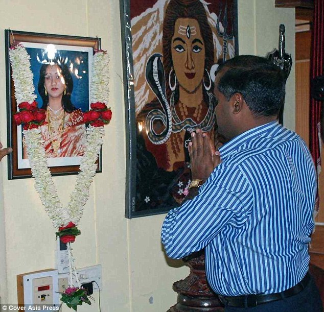 Paying respects: The deputy commissioner paused for a moment of reflection before Savita's shrine