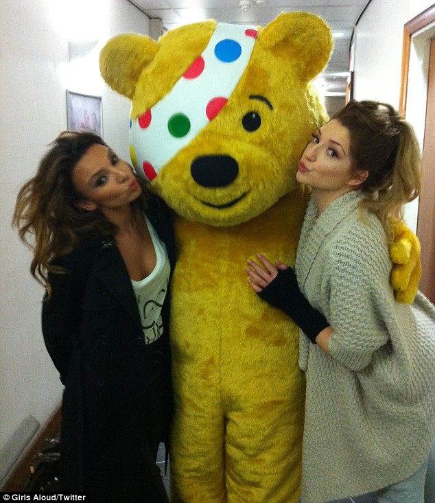 Look who we found backstage: Nadine and Nicola pucker up with Pudsey the bear