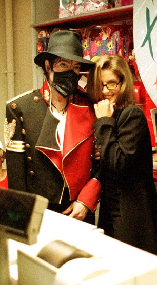 Out of control: Michael Jackson shopping with his wife Lisa Marie Presley in the mid-nineties