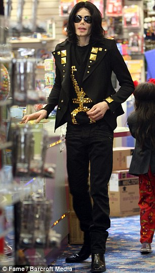 Michael Jackson and his children visiting a toy shop in Beverly Hills