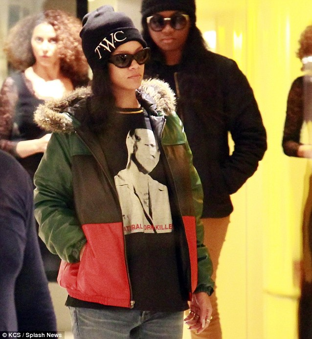 Dressed down: Rihanna wore a colourful coat to stay warm in the French capital city