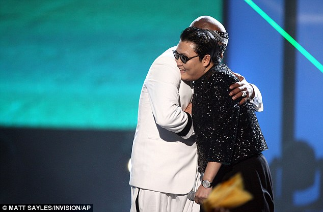 Congrats dude: The pop stars hugged it out after they closed the AMA's in style