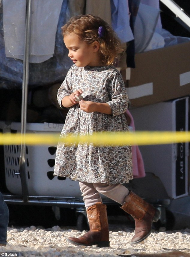 Cowboy kiddy: Little Vida McConaughey ran around the New Orleans location in some baby cowboy boots