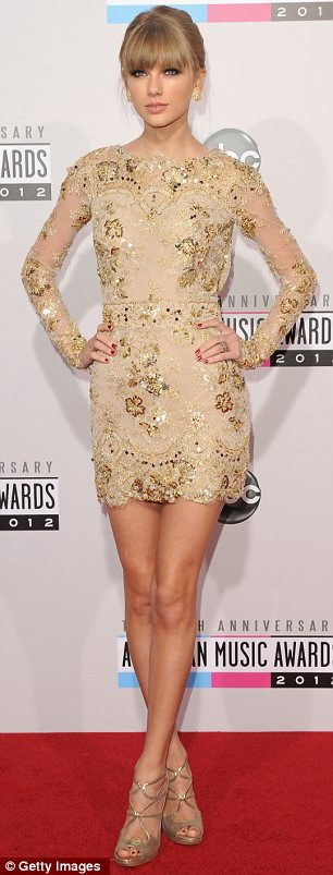 Just like Heidi: Taylor Swift went for a similar look in her embellished gold frock and neat bun