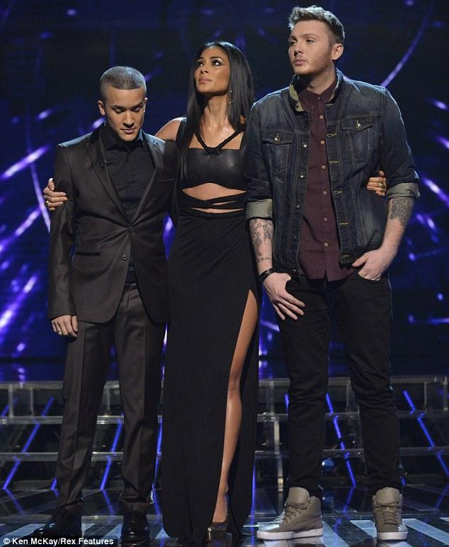 Leggy lady: Nicole shows some skin as as cuddles up to her acts James Arthur and Jahmene Douglas