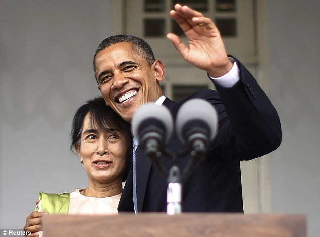 Close: Obama and Suu Kyi smile at the residence where she was held under house arrest for two decades