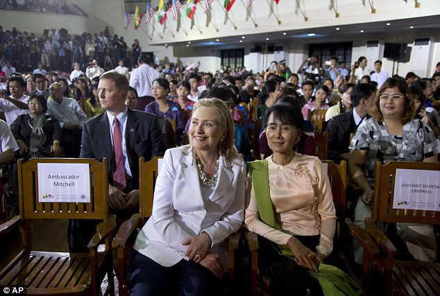Together: Clinton and Suu Kyi sit together as Obama speaks at University of Yangon
