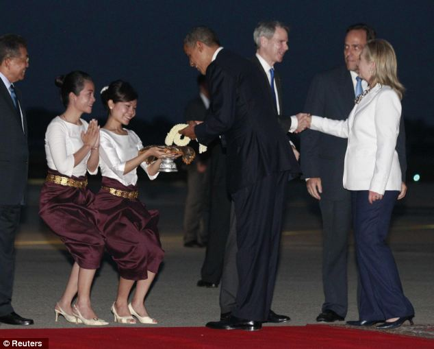 Next stop: Obama receives a floral tribute upon his arrival at Phnom Penh International Airport in Cambodia