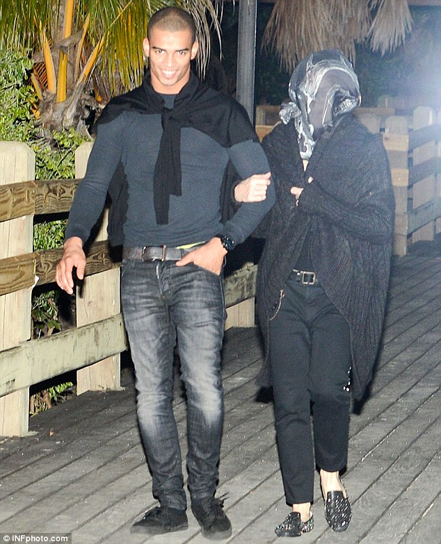 Material Girl in disguise: Madonna covered her face with a scarf while on her date with Brahim in Miami on Sunday