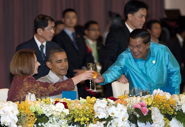 Business: Obama doesn't look in the party mood as Hun Sen toasts with Australian Prime Minister Julia Gillard