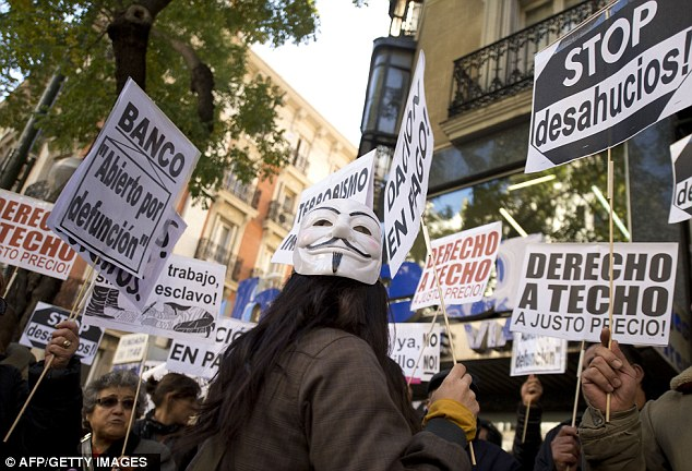 Unhappy: Residents in Madrid pictured protesting against evictions at the beginning of November after an estimated 350,000 were evicted from their homes in the wake of the recession