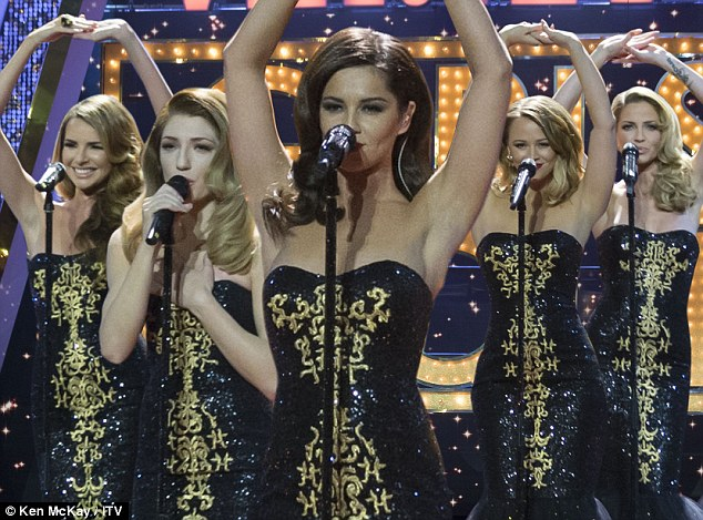 Perfect formation: Cheryl took centre stage as the girls performed their mirror-image moves