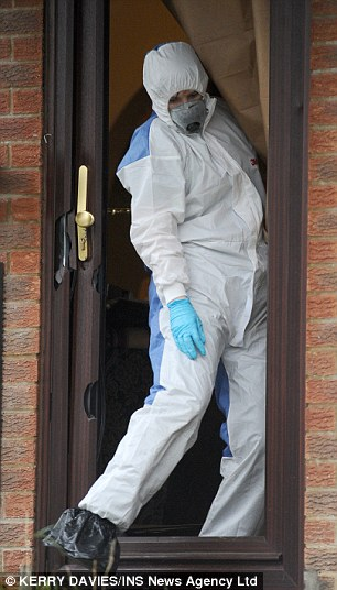 Scene of crime officers search a house raided this morning as part of Operation Ribbon