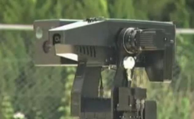 Automatic death: Samsung's machine gun sentry robot, which is already in use in South Korea, can spot unusual activity, challenge intruders and, when authorised by a human controller, open fire