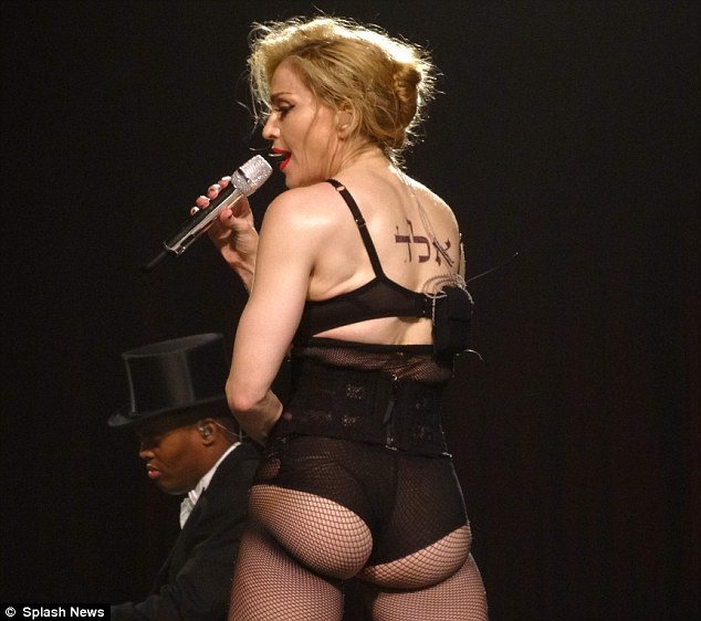 Undignified: Madonna should still perform, and she should dress up but as she nears 60, this kind of thing needs to stop