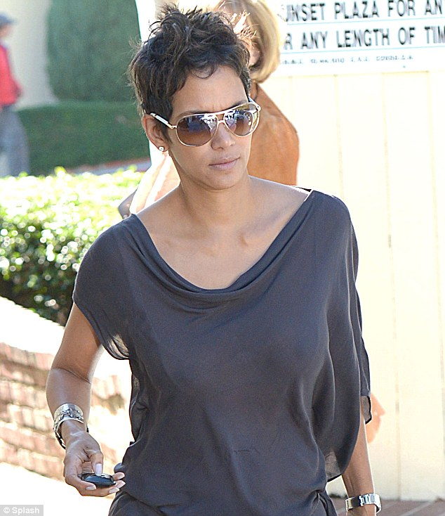 Dressed for comfort: Halle Berry wore a sheer, lightweight blouse to attend a lunch at Cafe Med in West Hollywood on Monday