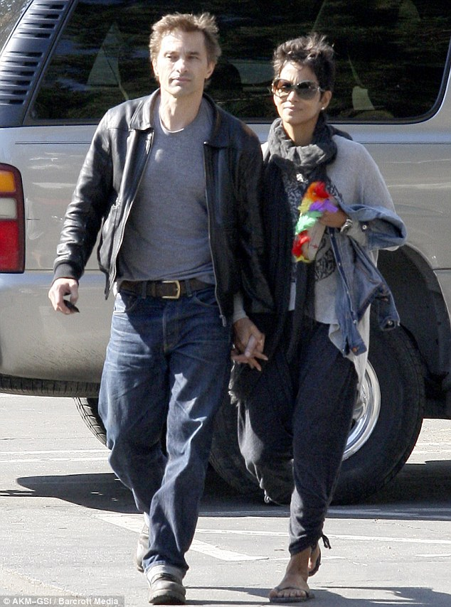 Partied out: Halle Berry and fiance Olivier Martinez leave a Thanksgiving party in L.A. holding hands