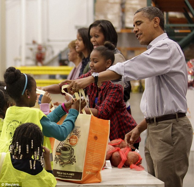 Holiday treats: The bags of food contained carrots, apples, sweet potatoes and special White House boxes of M&Ms