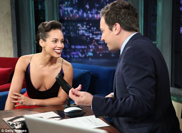 Here come the girls: Alicia Keys almost suffered an embarrassing wardrobe malfunction during an appearance on Late Night With Jimmy Fallon on Wednesday after her top slipped down to expose a bit too much cleavage