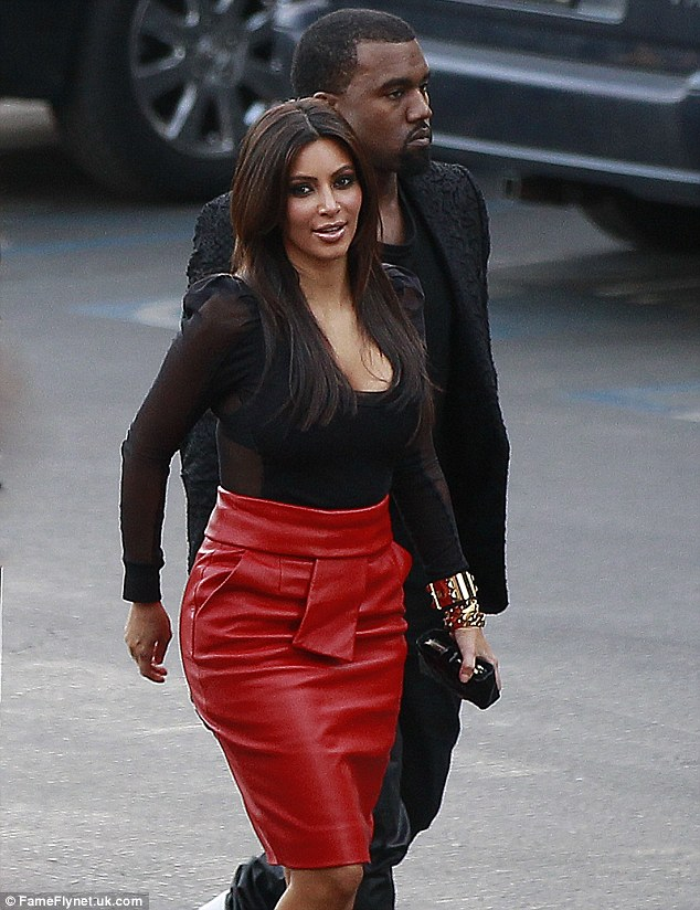 Keeping close: Kanye stayed close to his ladylove, who smiled for the cameras