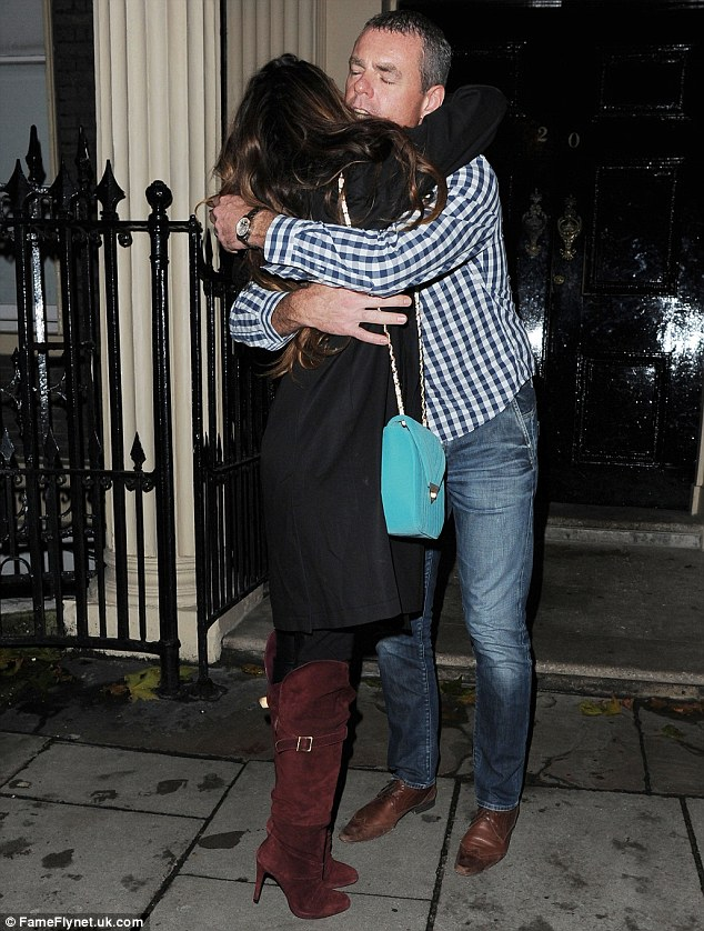 Companion: Nadine hugged a male pal before disappearing into the night