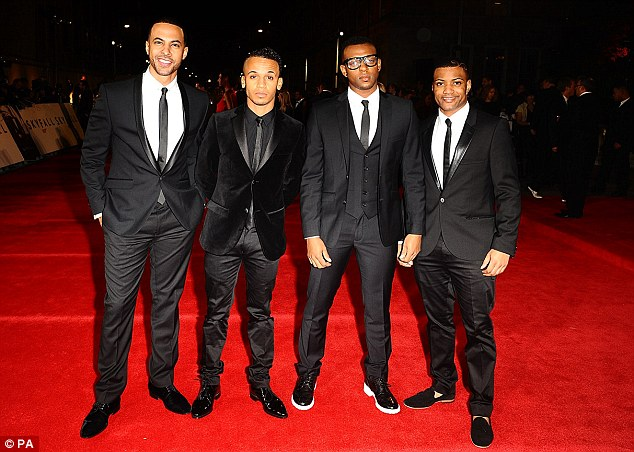 Dapper: Marvin and his JLS bandmates (L-R) Aston Merrygold, Ortise Williams and JB Gill