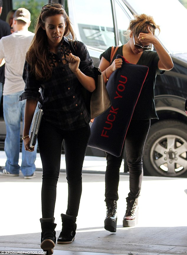 Baby on the way: Rochelle at Los Angeles' LAX airport on November 7 as she was preparing to reunite with her husband