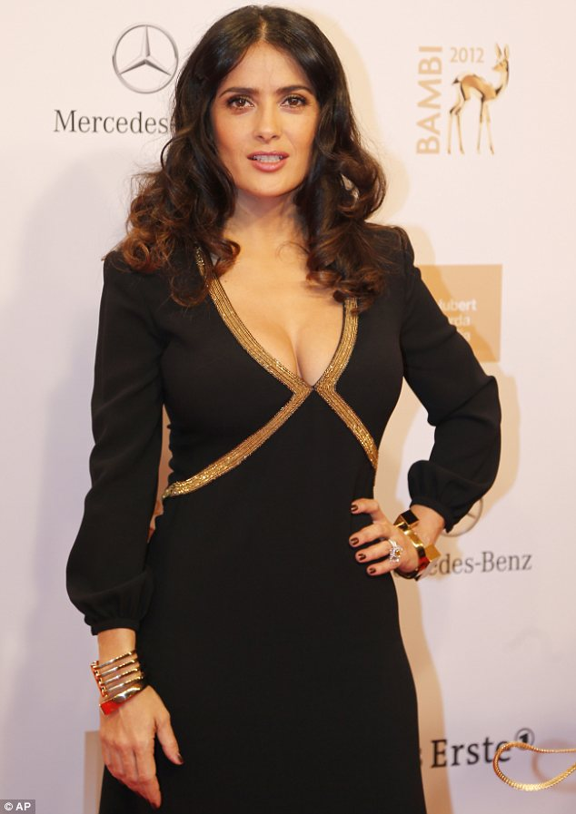 Curves on display: Salma was a sight for sore eyes with a deep low cut on her elegant dress