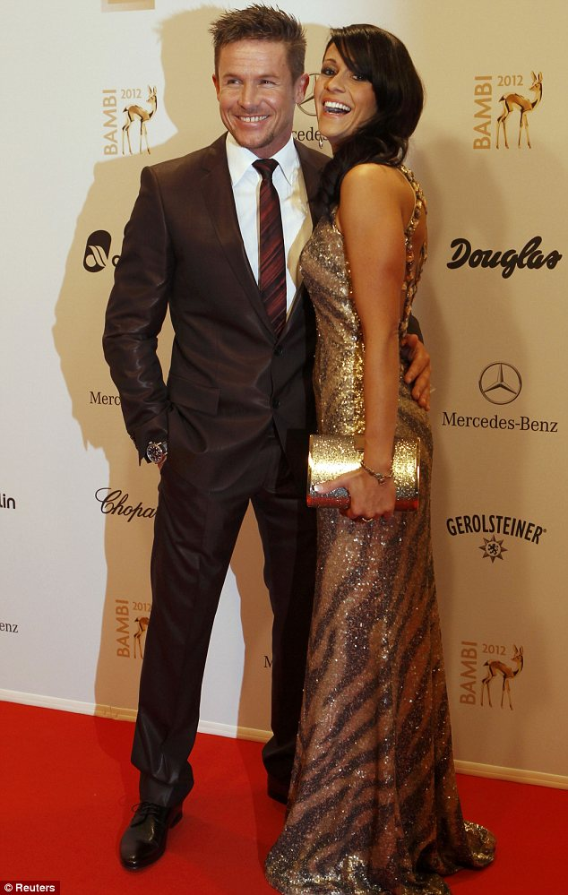 Rocketman: Austrian space jumper Felix Baumgartner posed up with his gorgeous girlfriend Nicole Oett