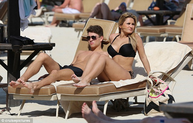 Feeling relaxed? The couple couldn't resist a spot of posing as they later kicked back on their sun loungers