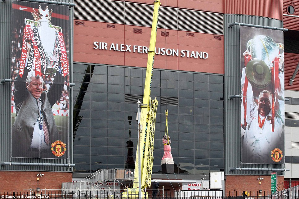 Almost ready: The Sir Alex Ferguson statue was lowered into place on Thursday outside Manchester United's Old Trafford stadium