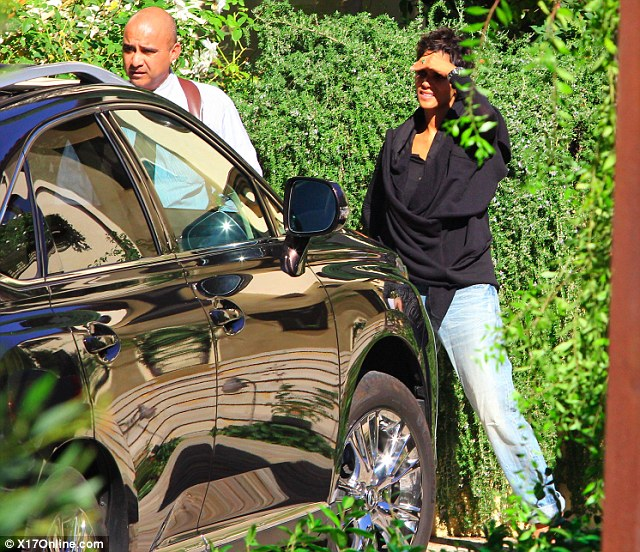 Home sweet home: Halle was later accompanied by bodyguards as she arrived home