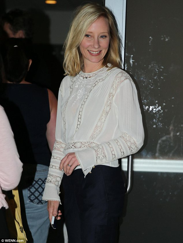 She had a great time: Anne Heche appeared to have enjoyed herself as she left the venue with a big smile
