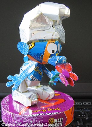 Smurf made out of soda cans