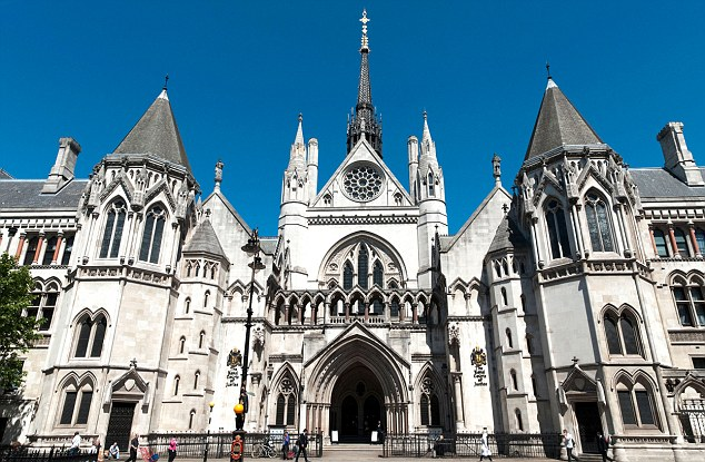 The landmark case is due to be heard at the High Court, pictured, next year. Ten women and one man are also suing the Met for emotional trauma
