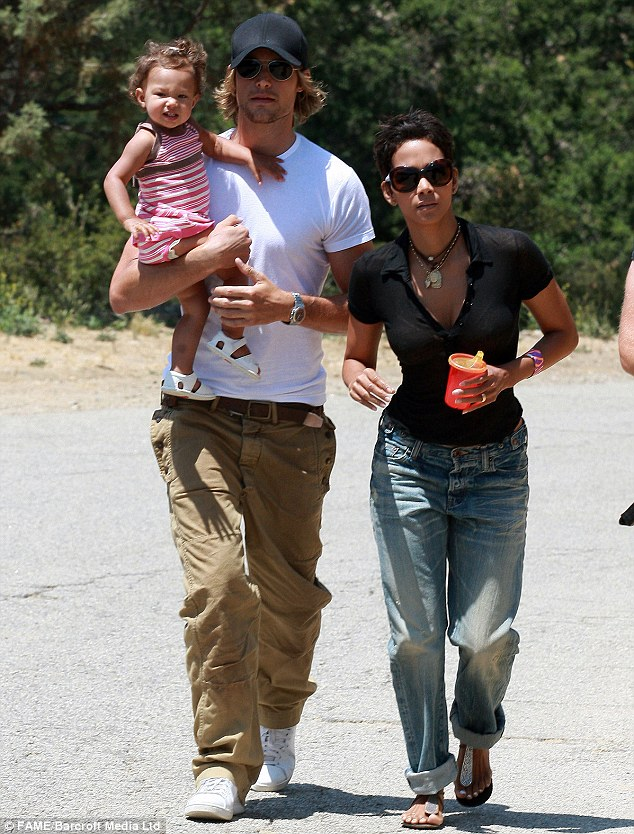 Back in the day: The former couple, here seen in 2009, have been involved in a bitter custody battle over four-year-old daughter Nahla, with Halle now trying to block all contact between the father and daughter