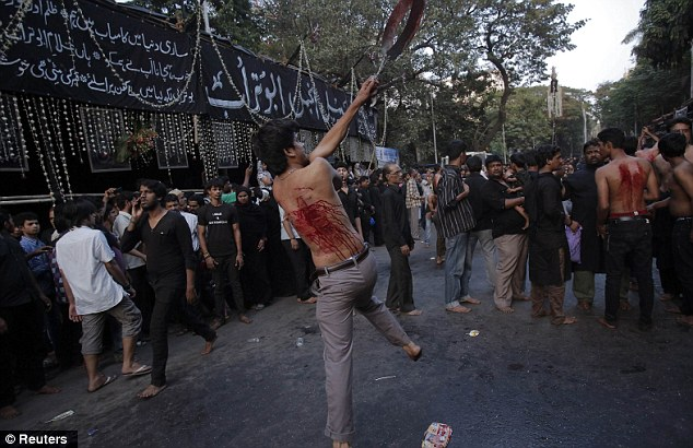 A Shiite at the Mumbai procession mourning the slaying of Imam Hussein